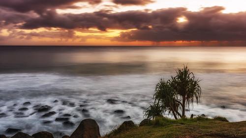 sky sunsetsandsunrisesgold sea slowshutteronwater sunrise sun goldcoast cloudsstormssunsetssunrises clouds water weather