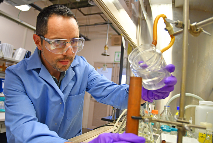 Chavez in his lab working on a possible TNT replacement, bis-oxadiazole.