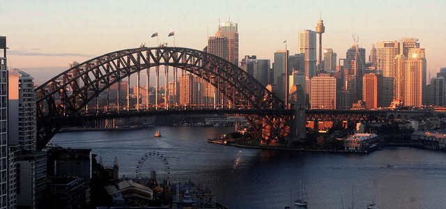 ()SYDNEY HARBOUR BRIDGE AND CITY AT SUNRISE.