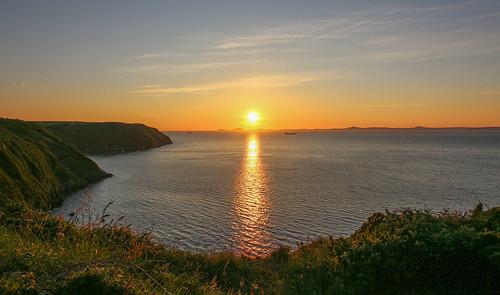 andygocher canon100d canon1018mm europe uk wales westwales southwales pembrokeshire coastalpath stbridesbay sunset littlehaven seascape sea reflection
