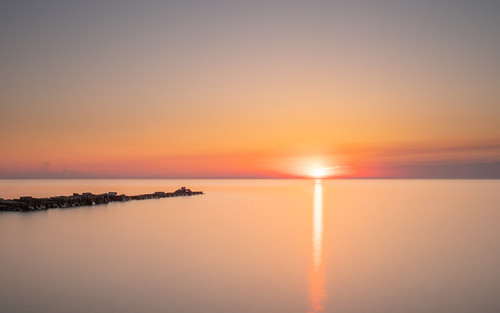 sunrise lakemichigan sun reflection longexposure rocks smooth minimalism minimal sky morning wisconsin atwaterpark shorewood midwest orange yellow olympusomdem1markii olympusmzuikodigitaled1240mmf28pro yextwisconsin wallpaper background