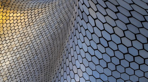 soumaya soymayamuseum museum outside externalart upclose abstract color sunset abstractart mexico mexicocity ciudaddemexico cdmx polanco tile metaltile wavepattern hexagon hexagonal pattern patterns repeating sunlight reflectingsunlight skyreflection colorful golden