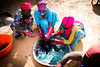 Women use dye to paint tissues which they will sell. Dyeing is another of the vocational training courses available for refugees and Chadians living in Farchana. The women wear protective masks to avoid any harm from the emanations of the dye.   © 2018 European Union (photo by Dominique Catton)