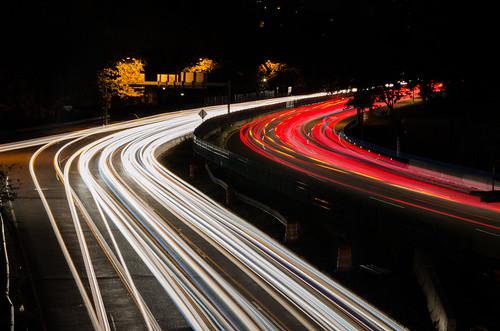 boston lighttrails lights traffic downtown massachusetts newengland city urban cars fastmoving red curve expressway boulevard longexposure polishflag