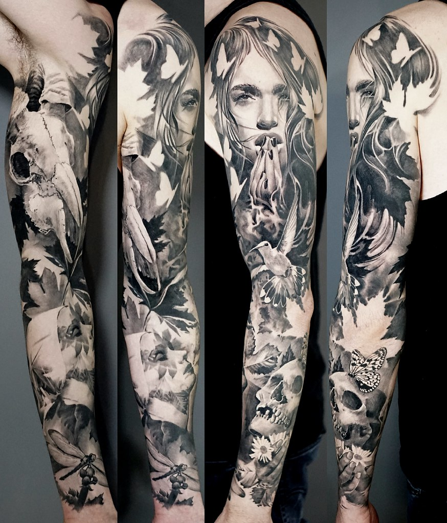 Black And Grey Healed Full Sleeve Tattoo Of Life And Death