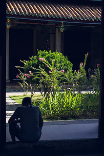Man resting at a Buddhist temple in Taipei, Taiwan