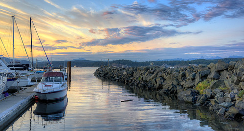 canada britishcolumbia seascape innerpassage campbellriver vancouverisland sunsets harbor harbour sky clouds boats jetty breakwater quadraisland