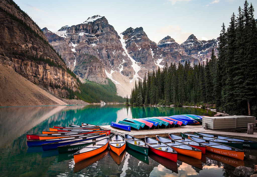 The Canoes Of Moraine Lake Alberta Canada Brian Pipe