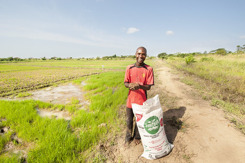 A farmer with a bag of fortifer in Kpong Irrigation Scheme, Asutuare in Ghana