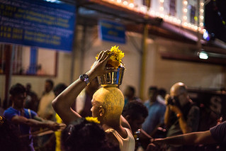 A man carries an offering toward the Hindu Temple during Thaipusam in Penang, Malaysia