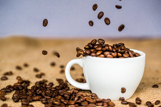 Coffee beans falling into a cup | by BryonLippincott