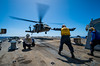 A U.S. Army HH-60L Black Hawk helicopter lands aboard USS Dewey (DDG 105). by Official U.S. Navy Imagery