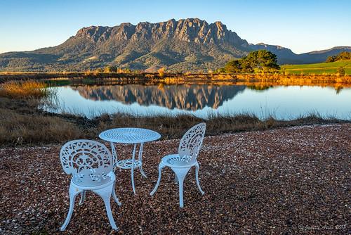 australia eaglesnestretreat mountain mtroland tasmania tassie westkentish dam landscape reflection sunrise water chairs table