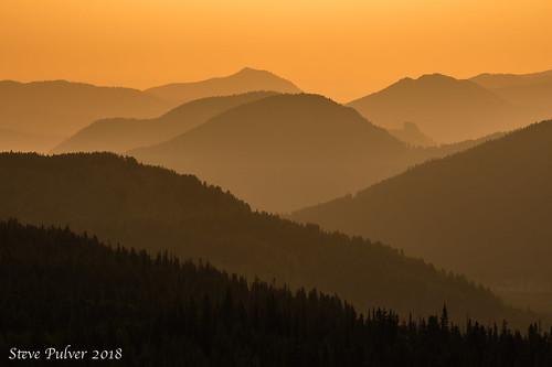 rockymountainnationalpark estespark rmnp nationalparks mountains backlight backlitmountains layers landscape sunrise orange colorado rockymountains nature
