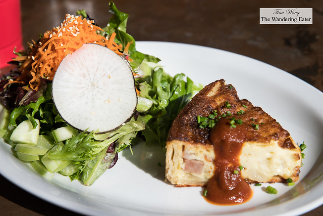 Quiche Lorraine (bacon, ham, gruyere) topped with house made maple ketchup and side salad