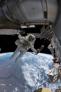 NASA astronaut Drew Feustel is pictured tethered to the International Space Station | by NASA Johnson