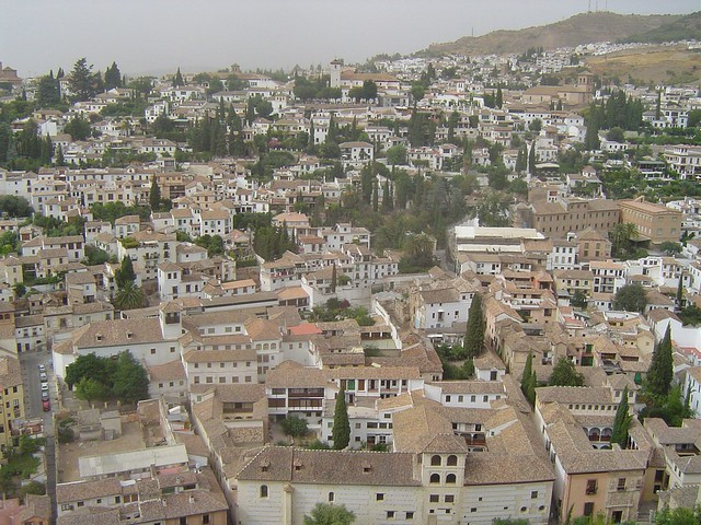 Looking down from the walls of the Alhambra to Granada's former Arabic barrio, the beautiful Albaicín! This is Granada's bohemian and artistic centre filled with live music. The network of winding cobbled streets and whitewashed houses perched on the hill