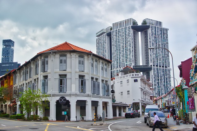 The modern architecture of The Pinnacle @ Duxton looming over heritage buildings in Chinatown, Singapore