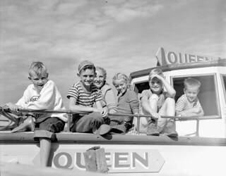 Children on board the motorboat Queen for an all-day cruise from Waskesiu to Kingsmere Portage... / Des enfants à bord du bateau à moteur Queen, croisière d'un jour de la jetée de Waskesiu au portage Kingsmere...