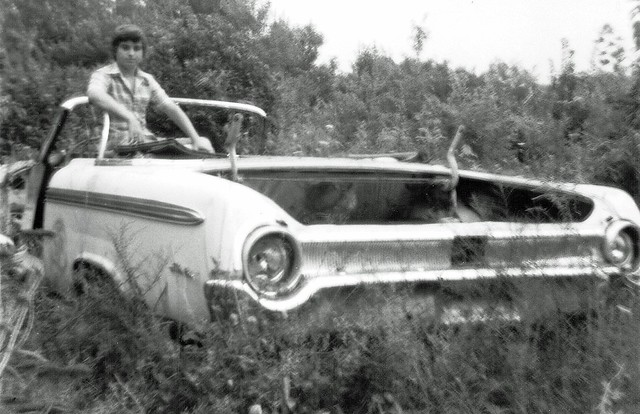 No shortage of abandoned cars in my old neighborhood!  A 1962 Ford Galaxie 500 Sunliner up on the hill behind the Variety Shop at the end of Seabreeze Ave. Yours truly in the driver's seat. It was totally infested with yellow jackets! Milford CT. Aug 1973
