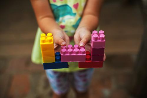 Colorful Toys in Child's Hands   by dejankrsmanovic