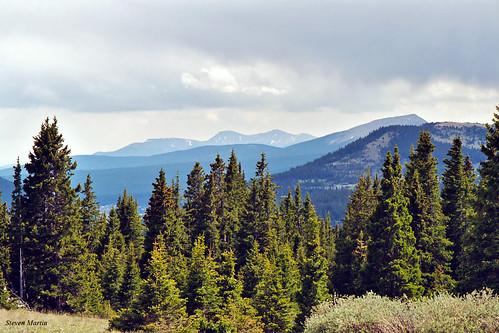 landscape scenery mountainpass mountains trees clouds colorado unitedstates