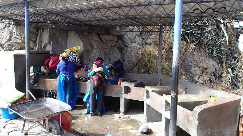 Tue, 2018-07-10 09:33 - Local ladies washing their clothes by hands.  It is a common scene in Huaraz.  Maybe many residents do not have water supply at home?  Certainly no washing machines for sure.