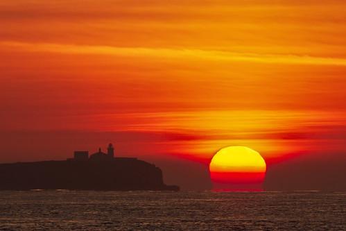 farneislands northumberland sunrise lighthouse sea ocean orange sky clouds burningsun bamburgh island