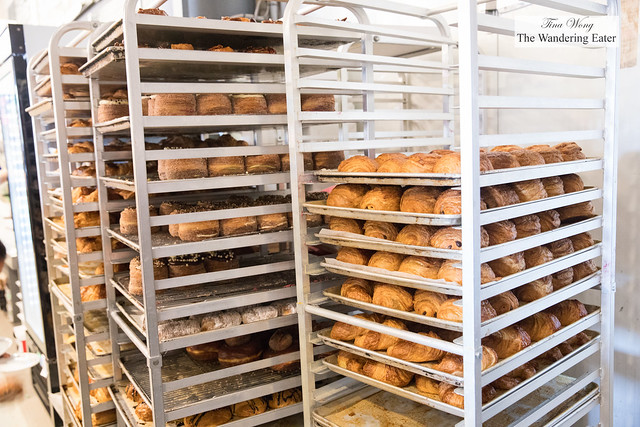 Racks of pastries near the retail display counter