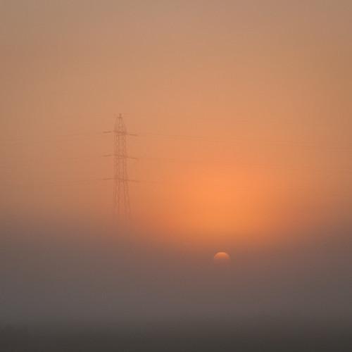 sunrise heindonk belgium transmission tower elektriciteitsmast mist fog