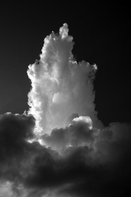Cumulus clouds with vertical growth creating dramatic cloud shap