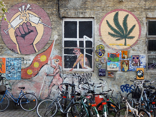 A mural in the counter-culture area of Copenhagen called Christiania. The bikes add another note.
