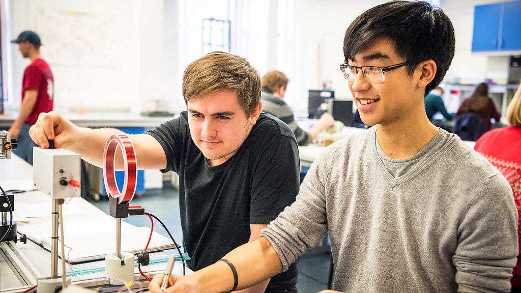 Students looking at Physics equipment