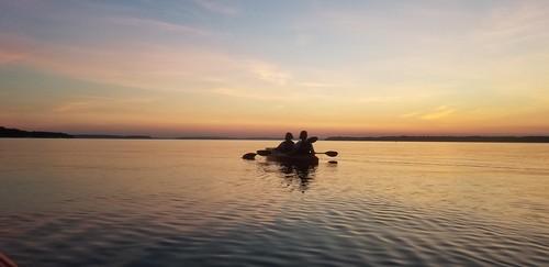 paddling sunset river water kayaking scenic inspiring