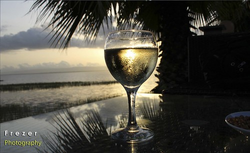 Enjoying lake Hawassa and  enjoying Ethiopian white wine 2 birds in one stone