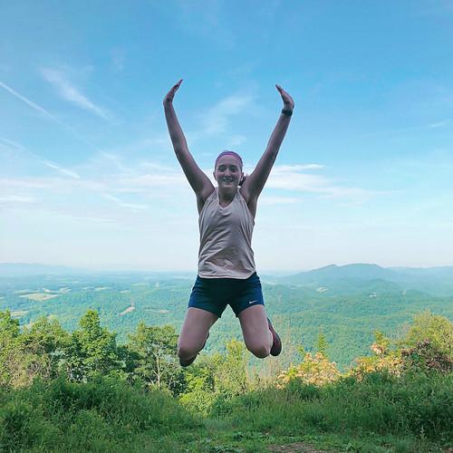 jump hiker reachedthetop view scenic lookout overlook girl