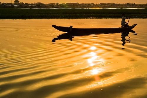 sunset reflection water landscape boat asia cambodia ripple phnom penh