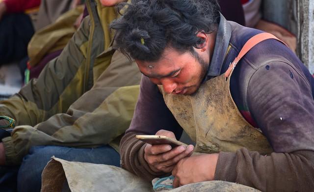 Mobile Pilgrim in front of Jokhang temple, Tibet 2017