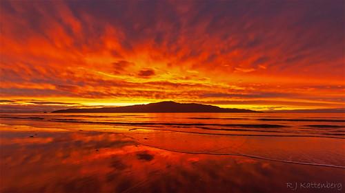 sunset sky sea silhouette sand rauoterangi channel kapiti island paraparaumu northisland newzealand natural wonders weather cloud coast canon eos500d wave water cloudsstormssunsetssunrises