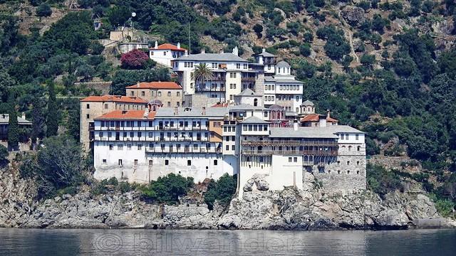 Greece, Macedonia, Aegean Sea, Osiou Grigoriou monastery view from a boat cruising around Mount Athos peninsula