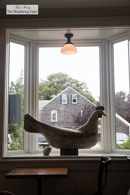 Adorable wooden chicken and egg sculpture at the bay window