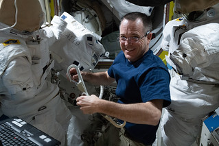Expedition 56 Flight Engineer Ricky Arnold inspects U.S. spacesuits and tethers   by NASA Johnson