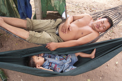 Father and child sleeping in a hammock / Cambodia | by Dick Verton ( more than 14.000.000 visitors )