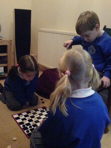 After school game of draughts | by usedcarspecialist