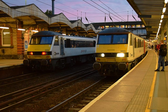 Greater Anglia 90008 on the left at Ipswich with the 2030 service from London Liverpool Street to Norwich and on the right 90011 rolls in with the 2100 Norwich to Liverpool Street. 23 06 2018