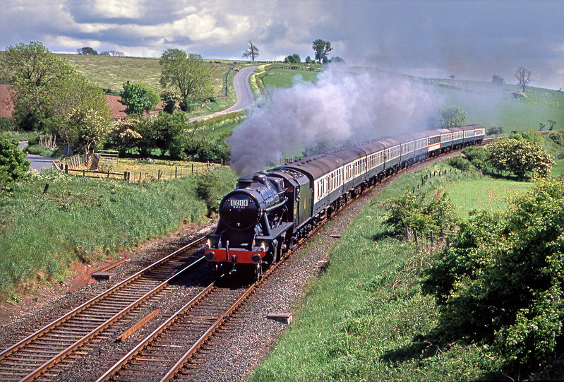 8F 48151 hurries north through Langwathby with the Midland Borderer which had originated in Leicester with steam haulage between Hellifield-Carlisle and return to Skpiton.  Pentax Spotmatic. Fuji 100.