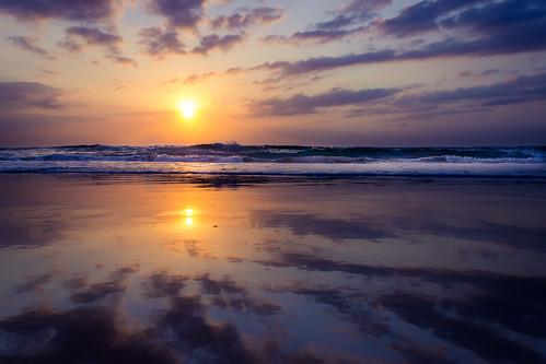 water sea ocean sky cloud sunrise shore mirrored