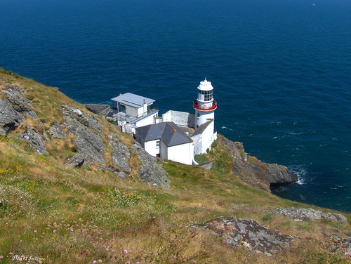 1p1140772 headland lighthouse vikings white town ad 795 history sea ireland rocks coast