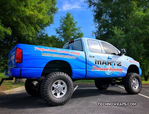 Vinyl truck wrap by TechnoSigns in Orlando, Florida