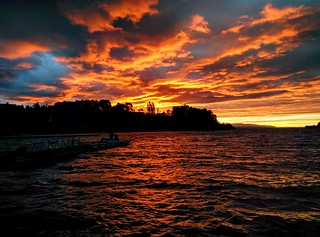 Vivid orange sunset over lake Lago Villarrica (from previous night) | by steve.upton